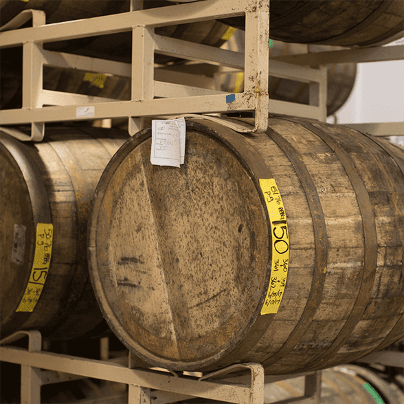 Multiple stacked wooden barrels