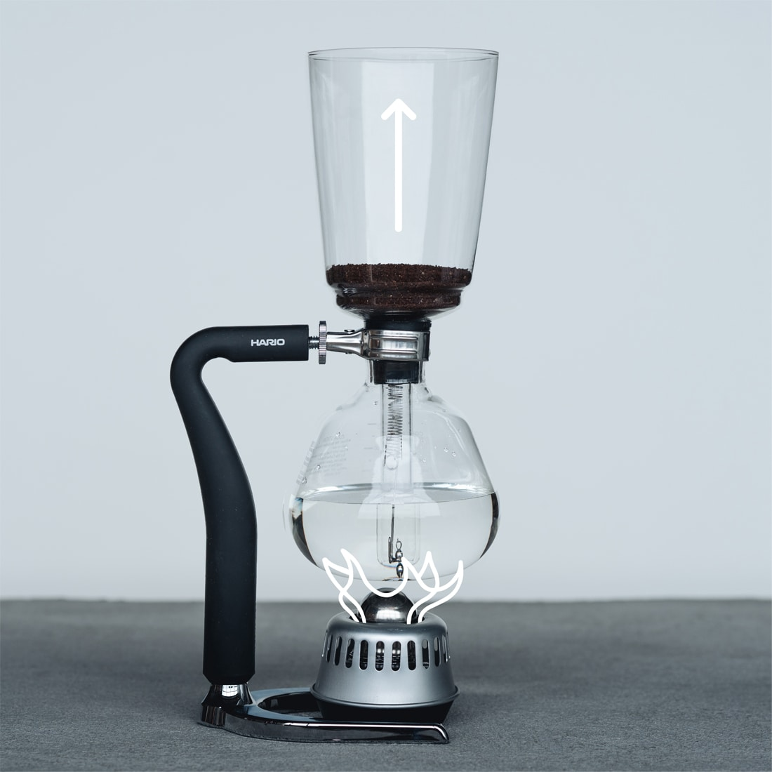 Siphon brewer with overlaid line illustration of a flame at the base of the brewer