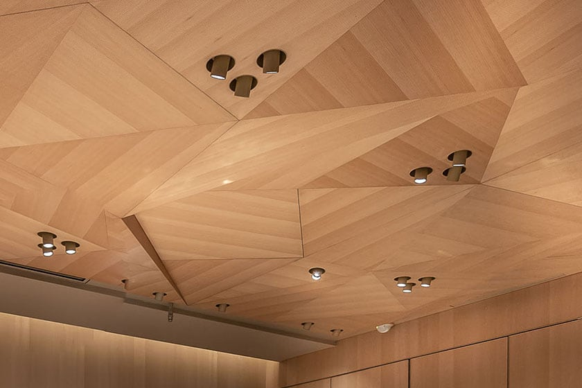 Origami-inspired ceiling featuring intricate geometric designs