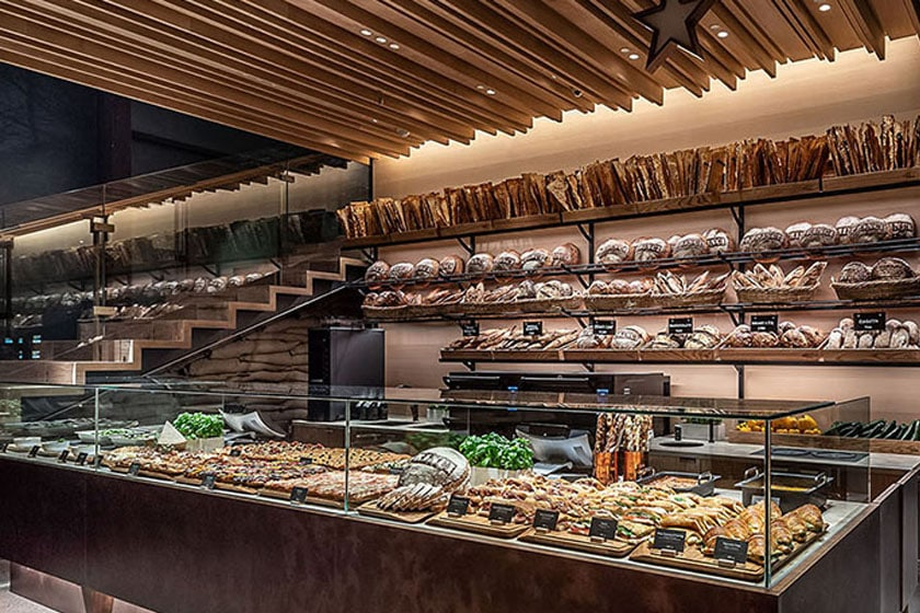 Princi Bakery in the Tokyo Roastery displaying a variety of breads, sandwiches, pastries and vegetables