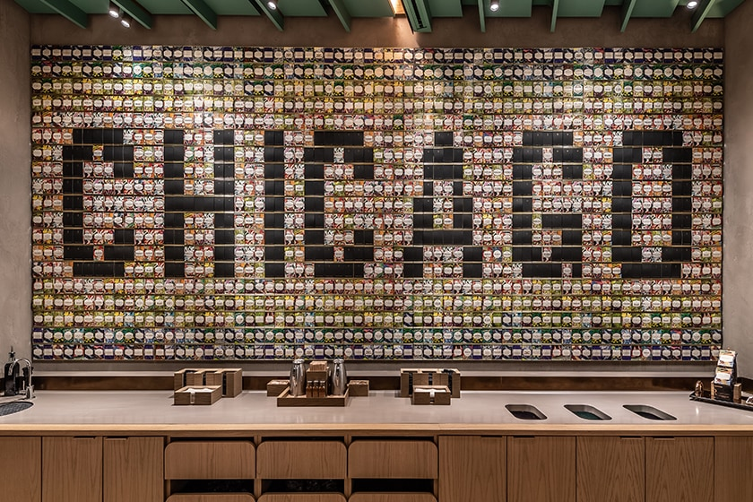 "Rectangular display of hundreds of colorful Starbucks Reserve coffee cards on a large wall, with ""CHICAGO"" spelled out within"