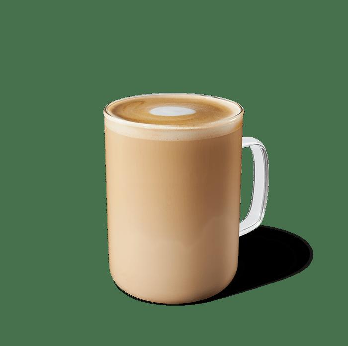Glass of an almondmilk honey flat white