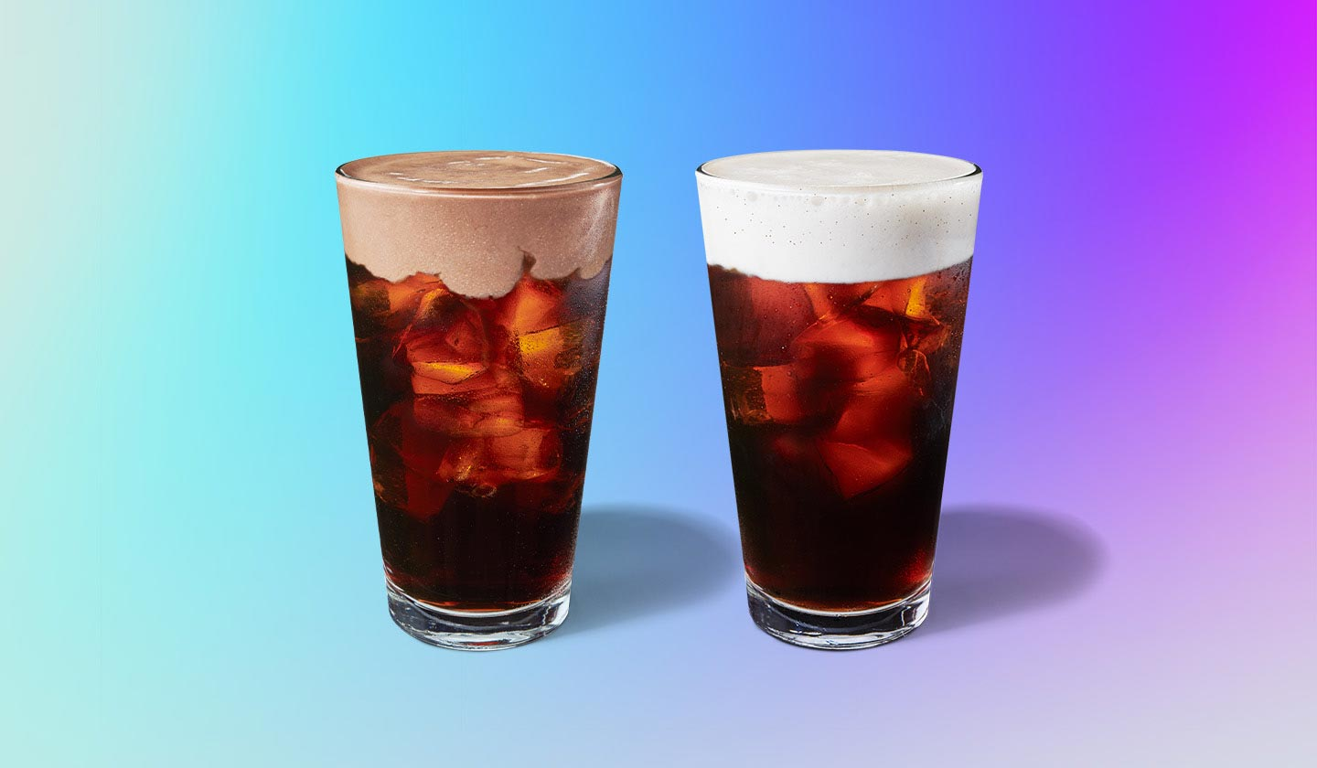 Two coffee beverages side by side with foam topping