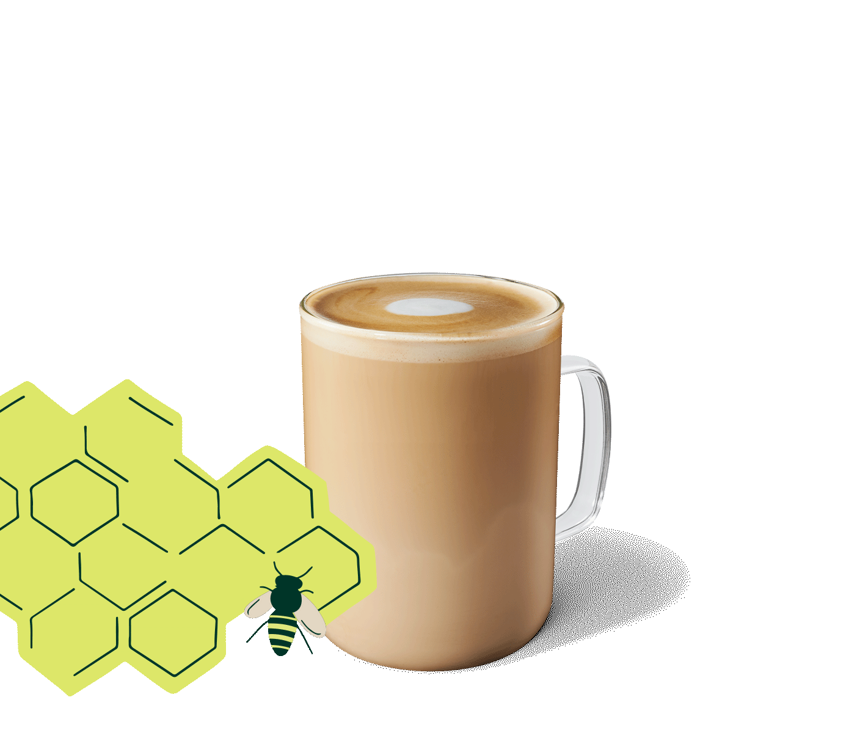 Honey Almondmilk Flat White in a glass mug.