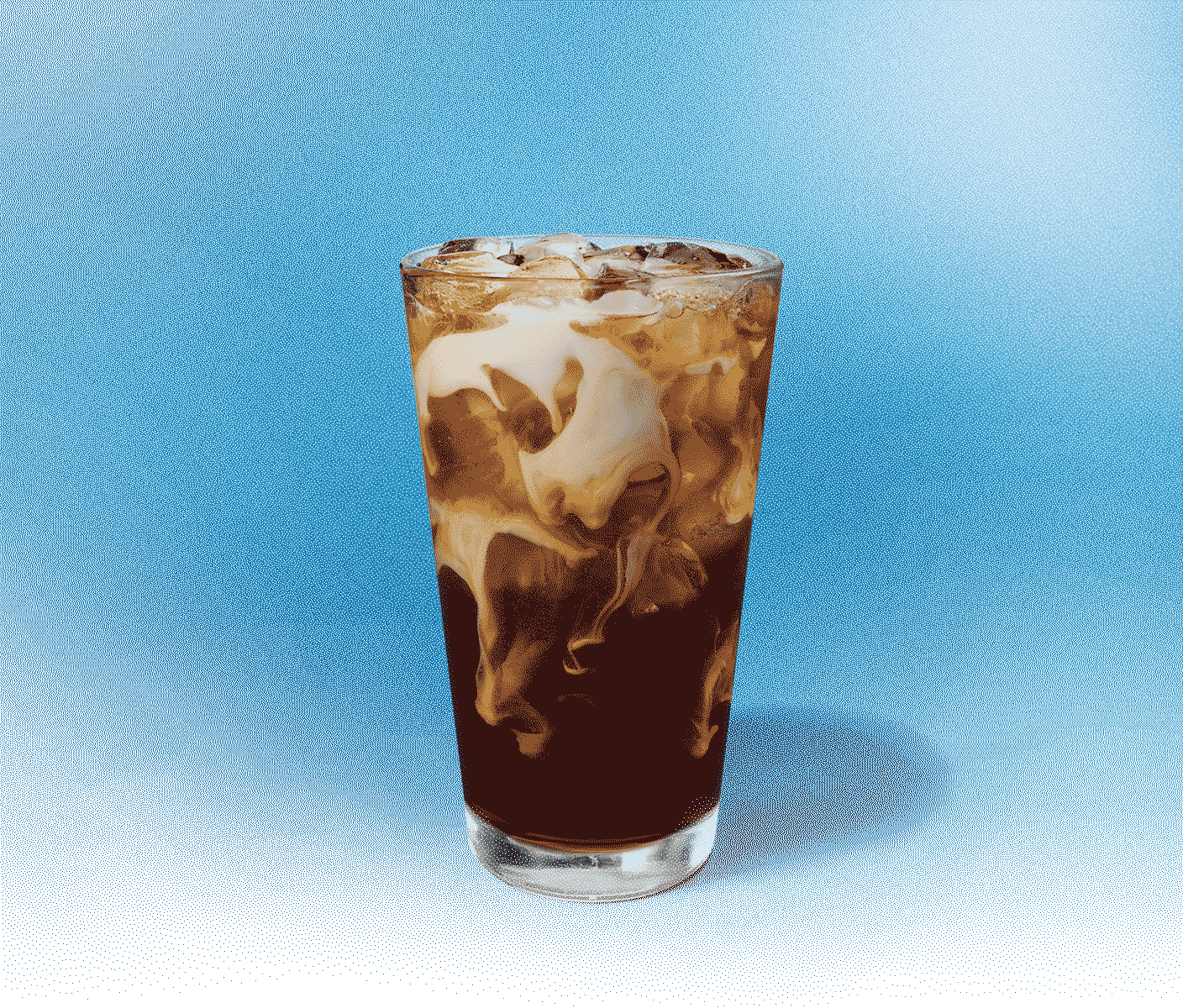 Tall glass of cold coffee with creamy swirls