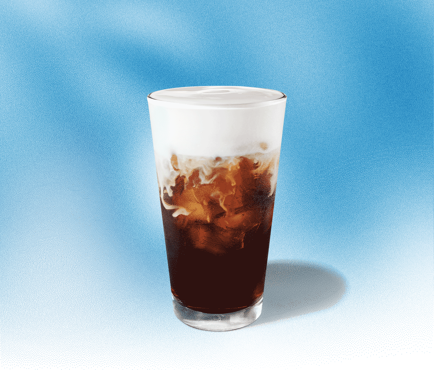 Tall glass of cold coffee with foamy topping