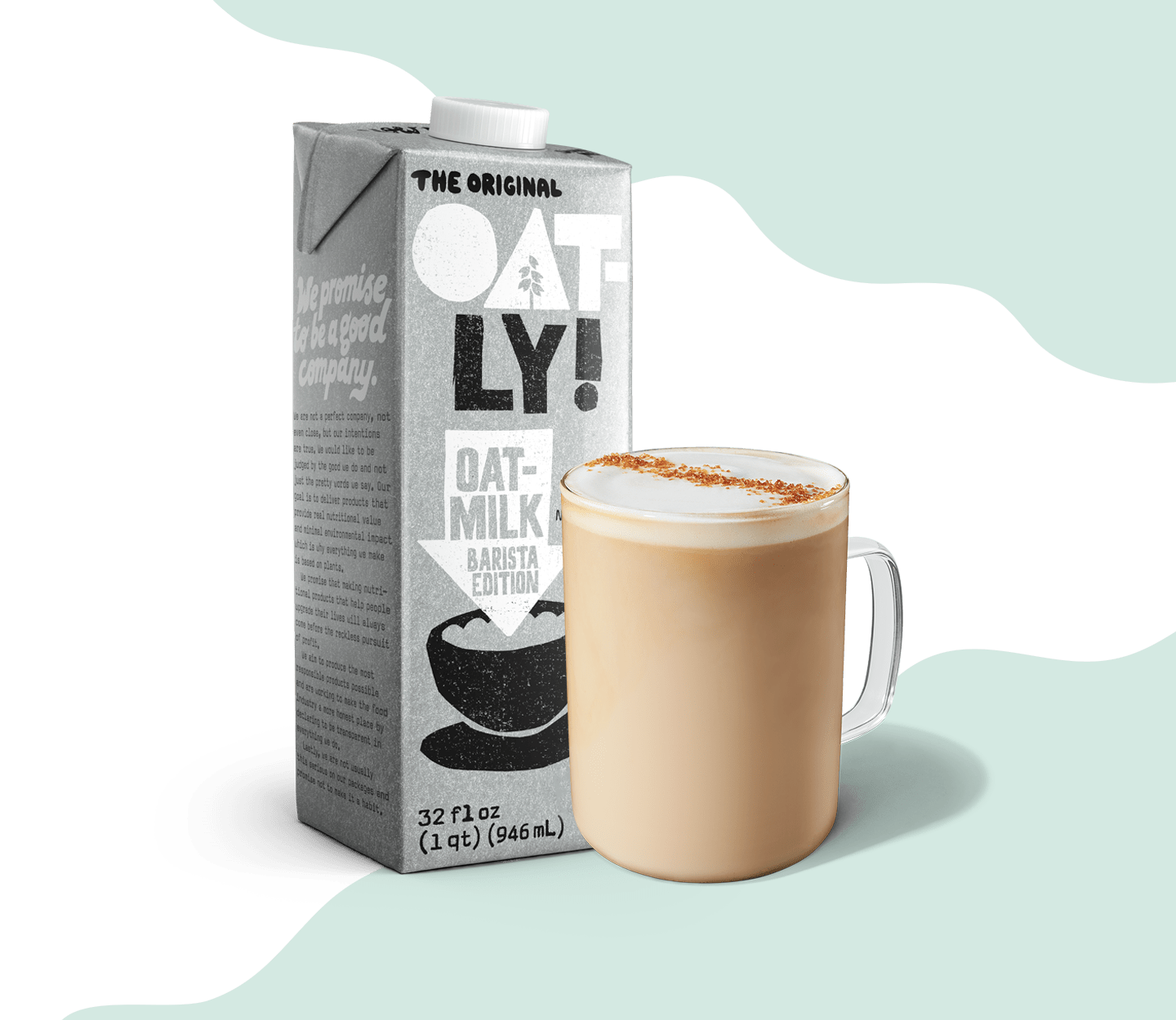 A carton of OATLY Oatmilk sits next to a finished latte in a glass mug.