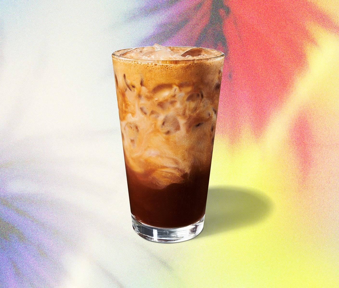 Layered, iced espresso beverage in a glass.