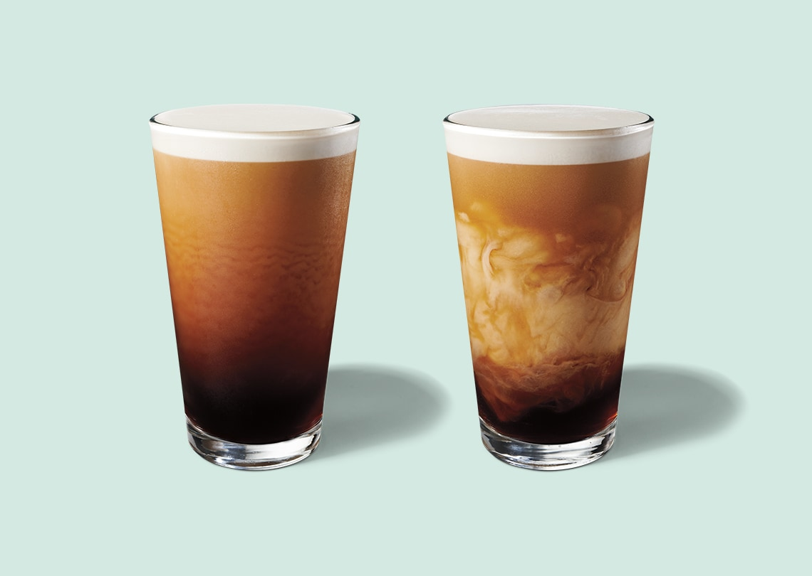 Two nitro cold brew beverages in clear glasses.