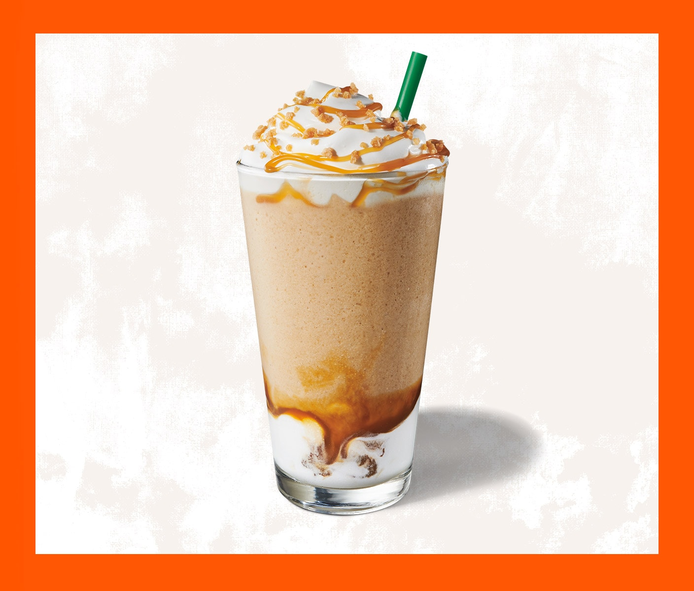 Blended coffee drink with whip cream in a tall glass.