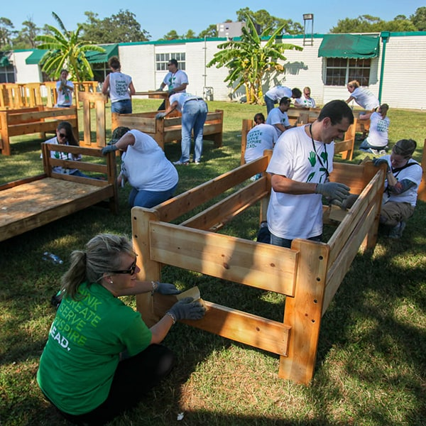 Group of partners volunteering to build flower beds