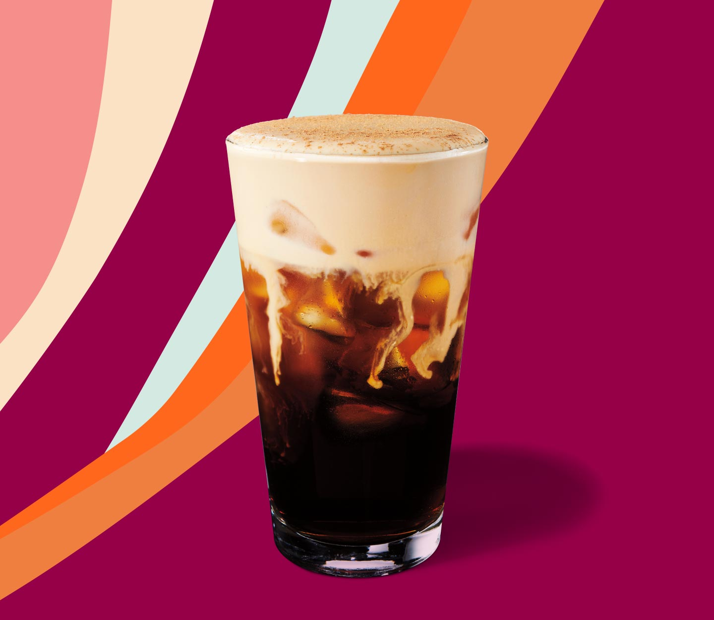 Cold brew topped with cream and served in a tall glass.