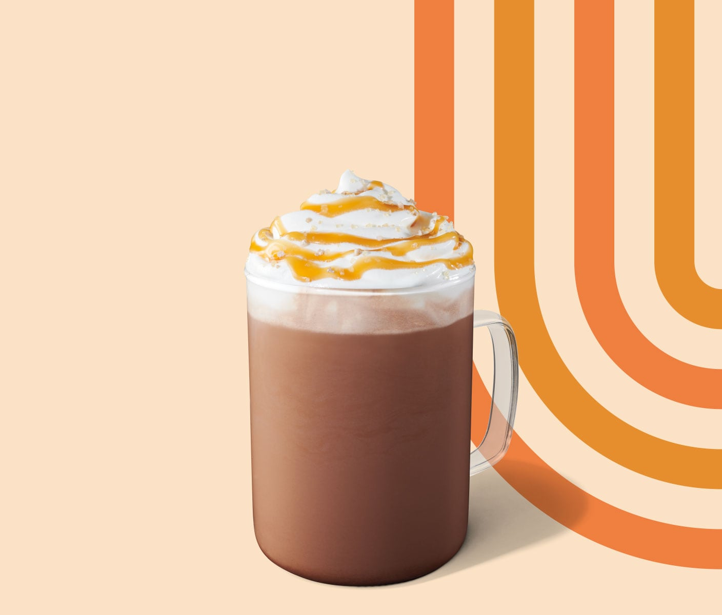 Mocha topped with whipped cream and served in a glass mug.