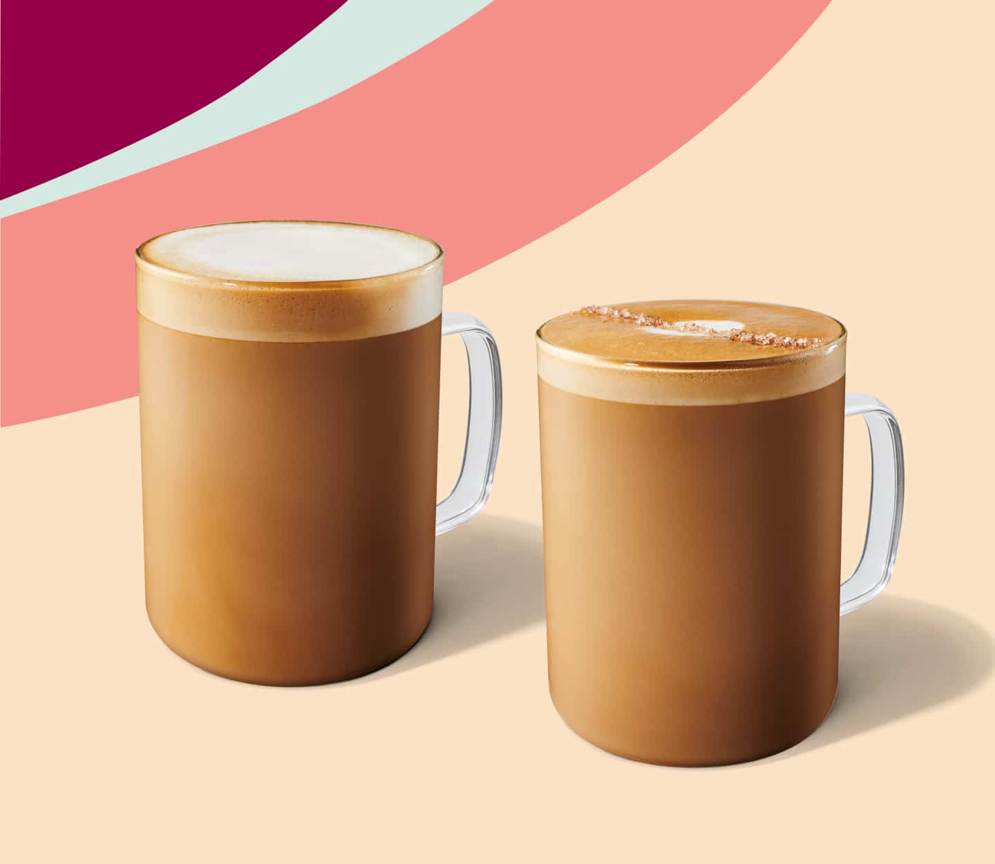 Latte and flat white served in glass mugs.