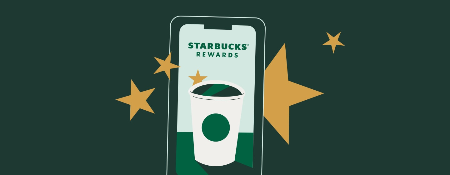A Starbucks beverage sits in the middle of a phone.