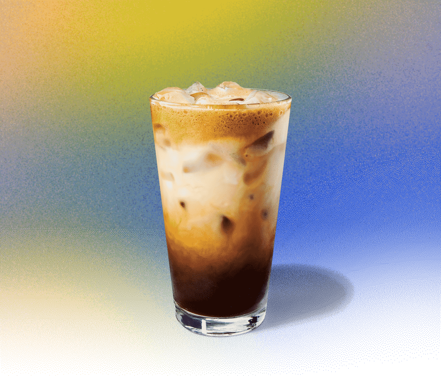 Iced coffee drink with creamy swirls in a tall glass