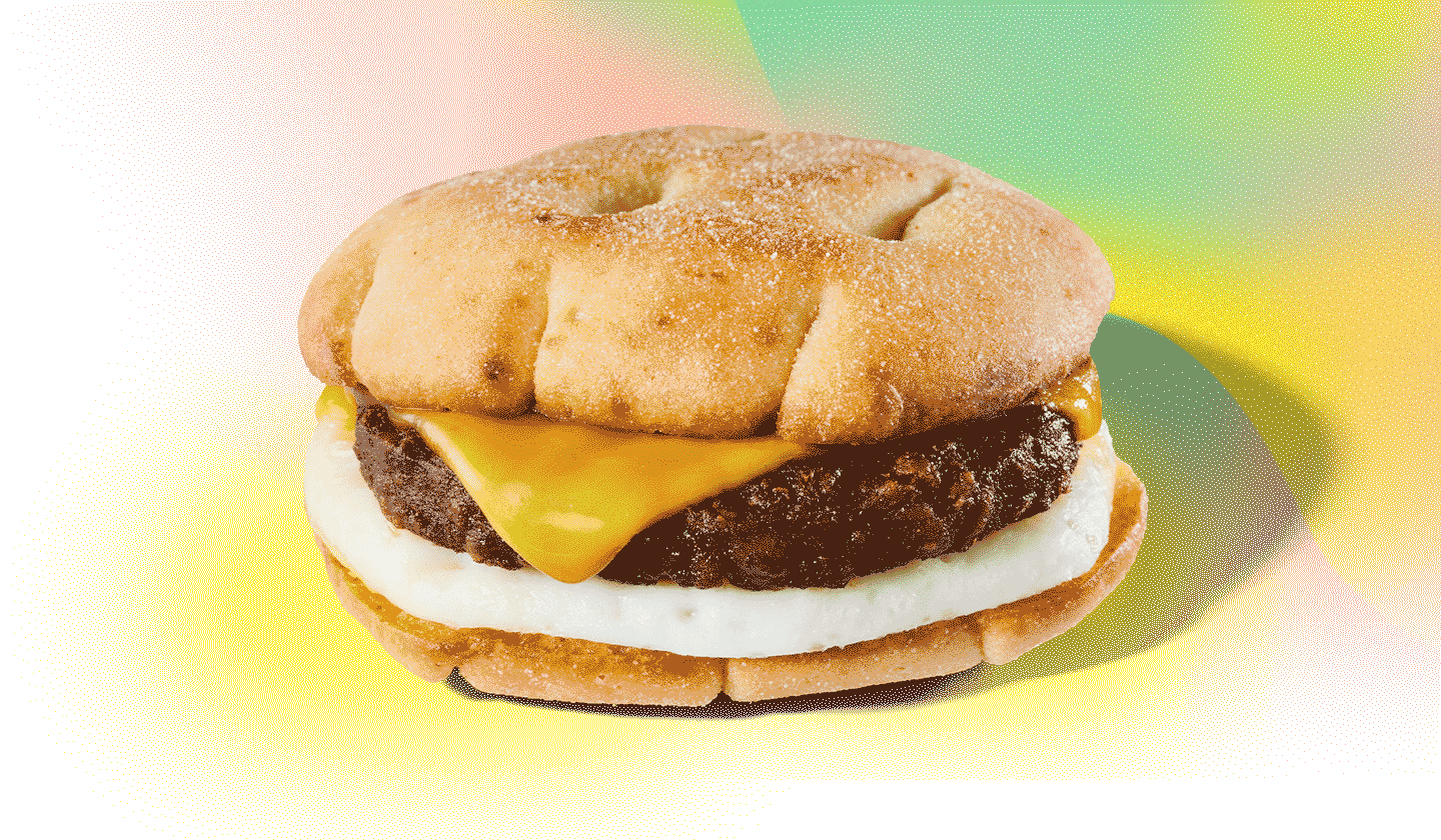 A stacked sandwich against a colourful background