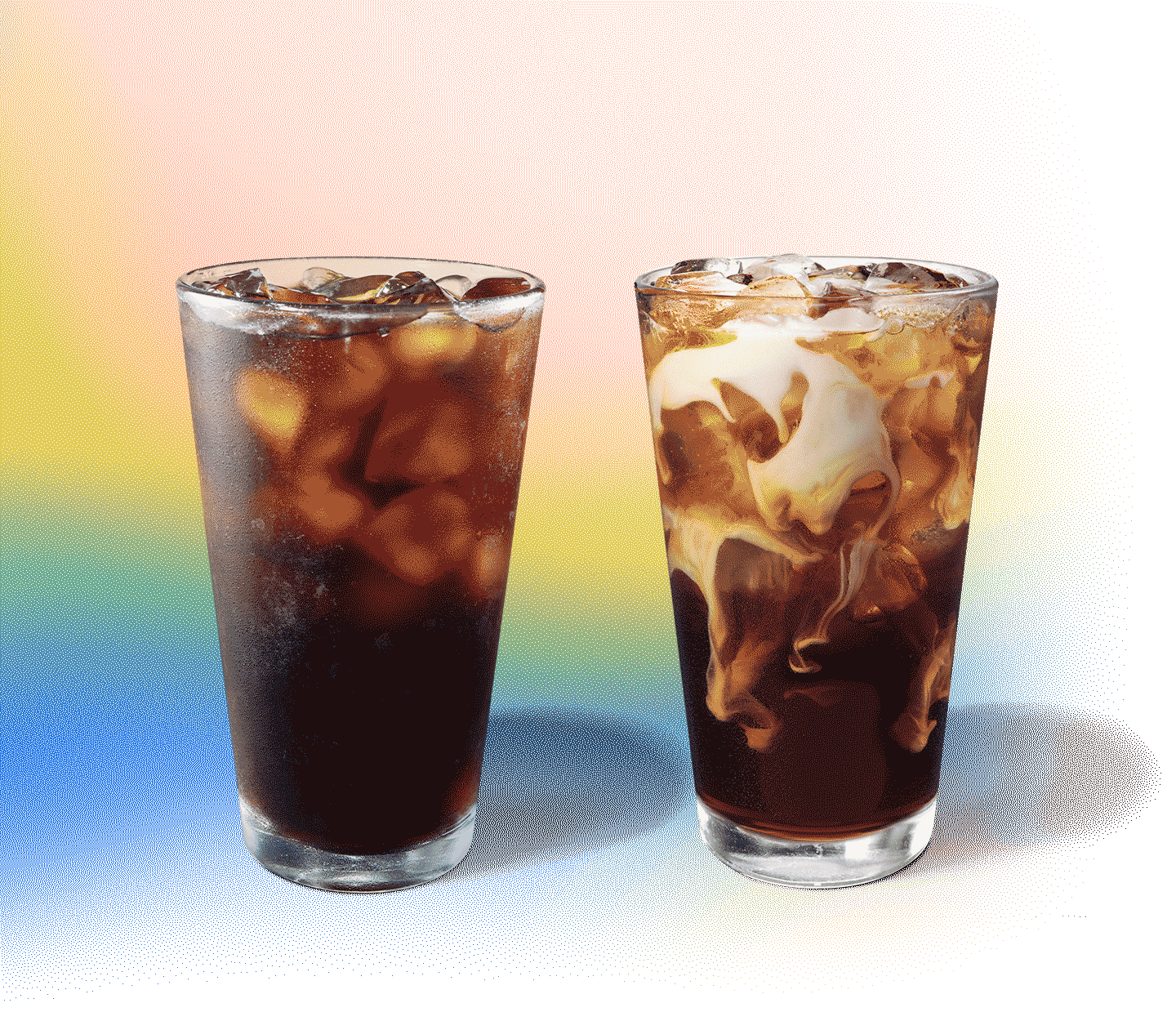 Two iced coffee drinks sit next to each other, one with creamy swirls.