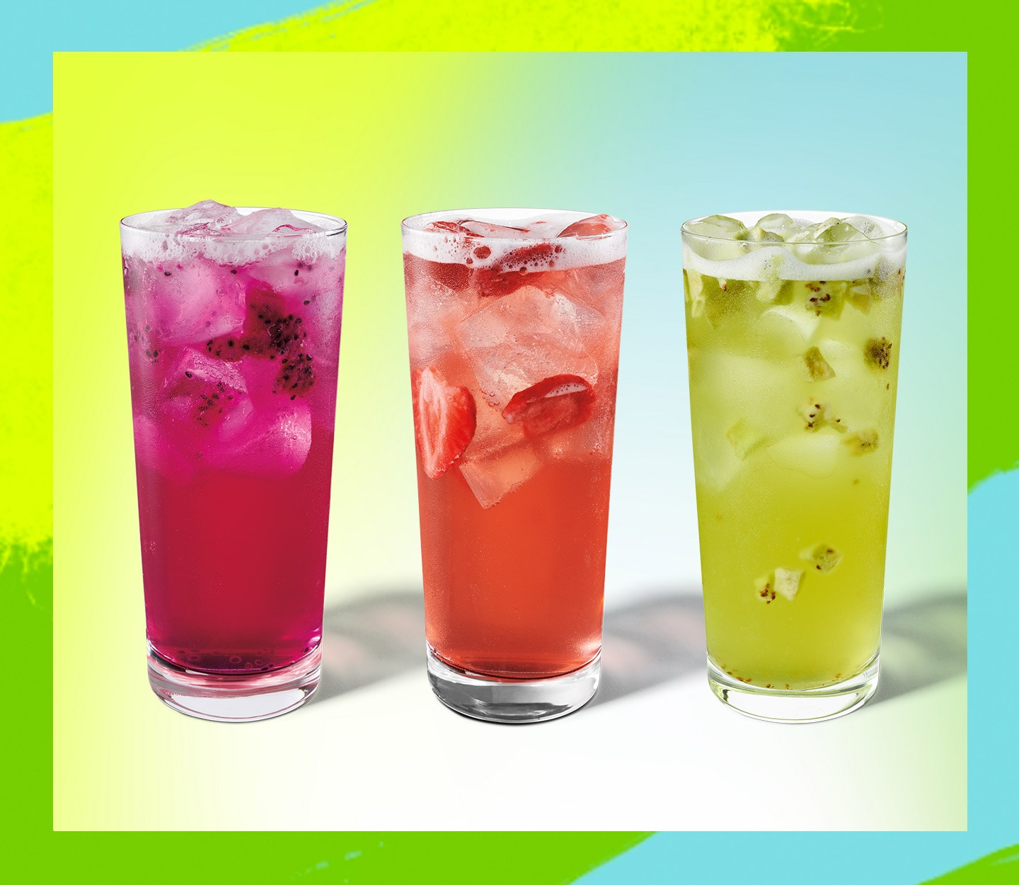 Three colourful iced beverages in glasses.