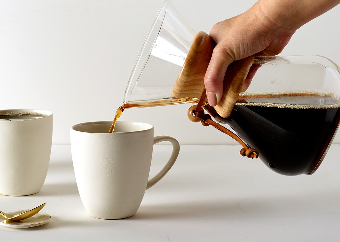 Flash brewed coffee being poured in a mug.