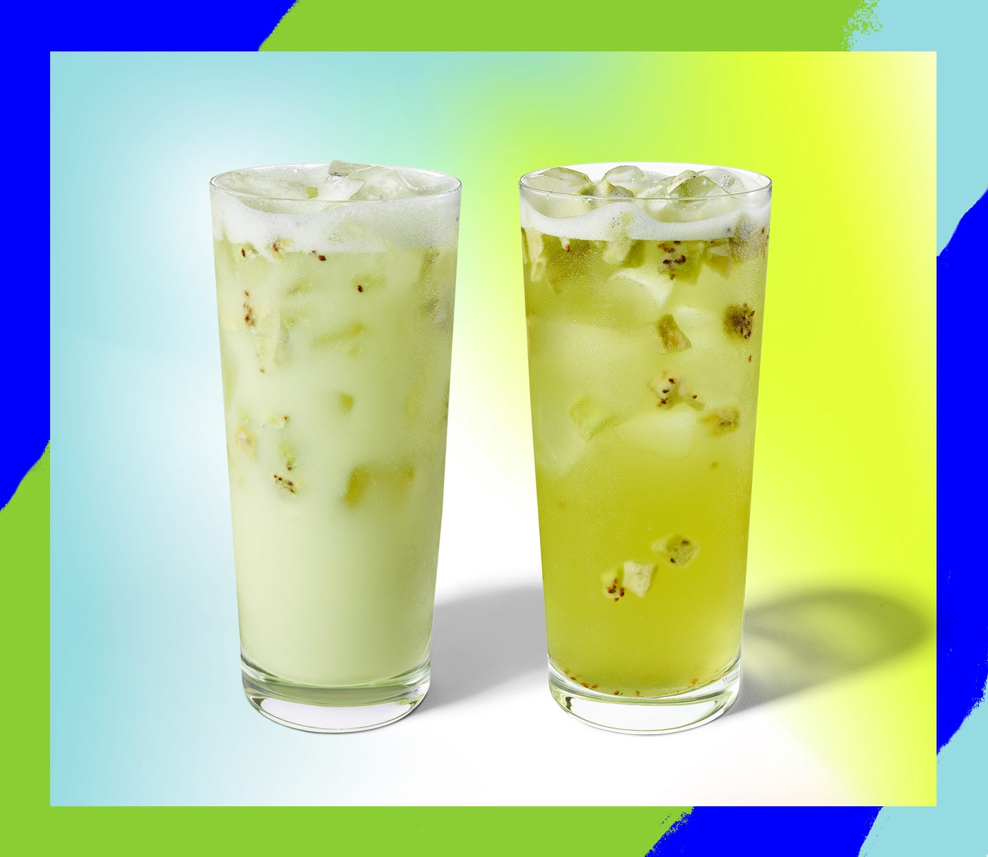 Two iced drinks in identical tall glasses sit next to each other.