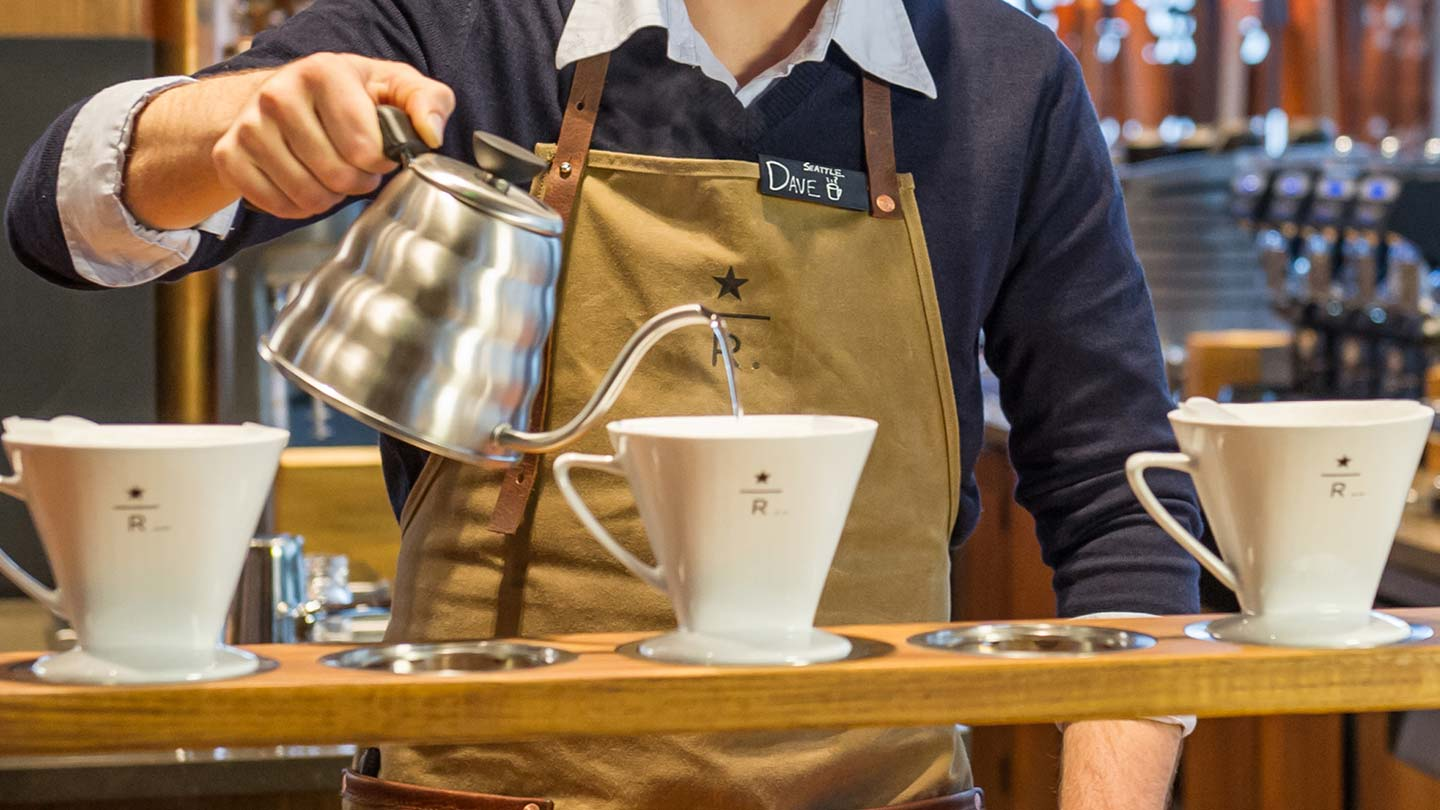 Starbucks barista serving pour over coffee