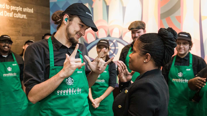 Starbucks partners communicating in ASL