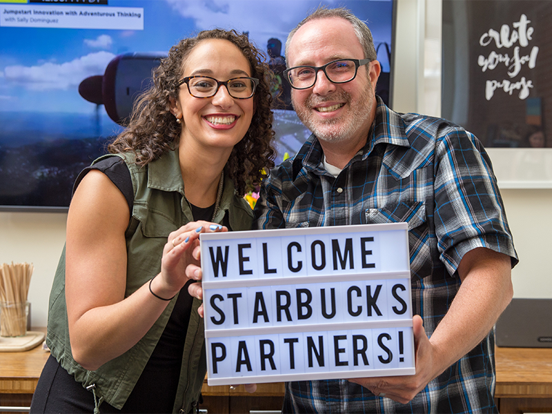Starbucks partners holding welcome sign