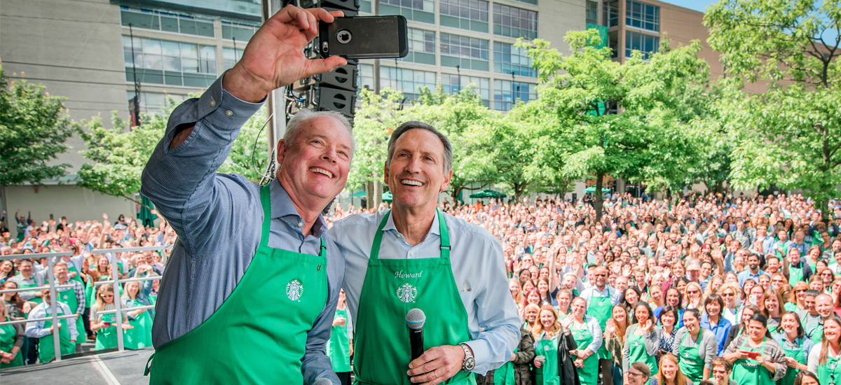Howard Shultz and Kevin Johnson taking a selfie