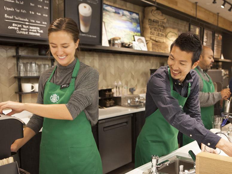 Starbucks baristas making beverages