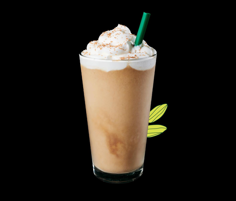 Une boisson frappée Frappuccino® à la pistache dans un verre avec une paille.
