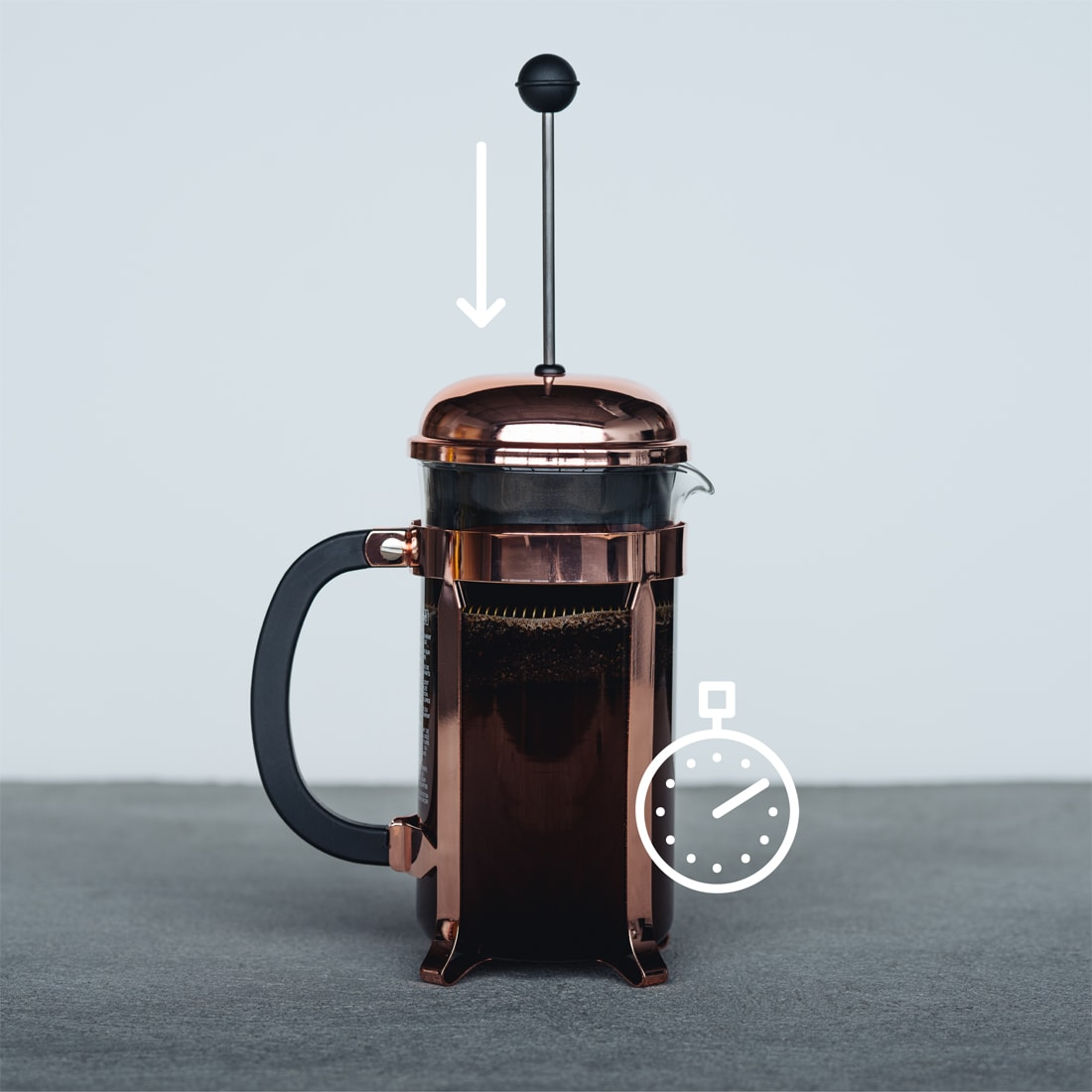 French press with overlaid line illustrations of stopwatch and and a downward arrow near the top of the french press