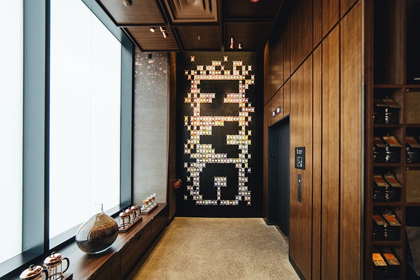 Display of dozens of colorful Starbucks Reserve Coffee Cards on a black wall