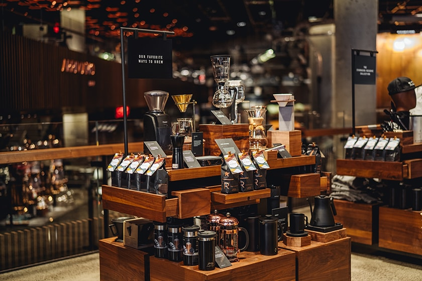 Display table with Starbucks Reserve coffee and a variety of coffee brewing equipment