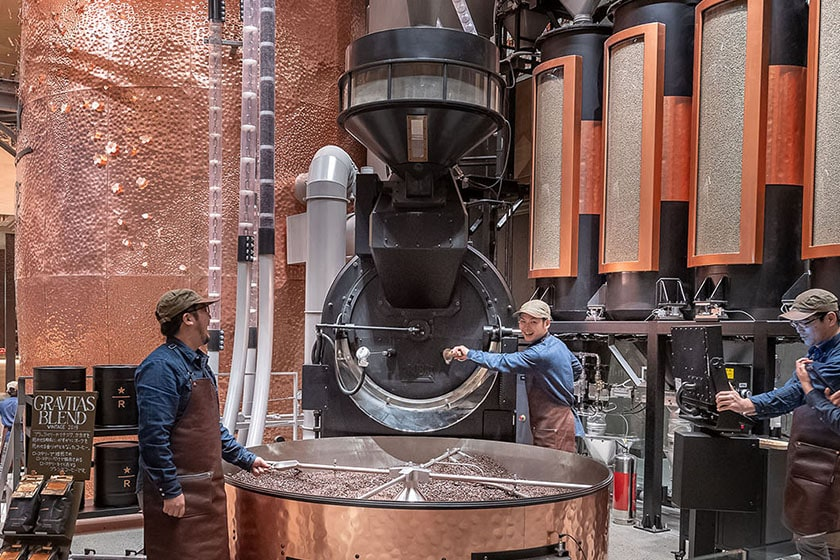 Master Roasters roasting coffee with the large roaster on the ground floor of the Tokyo Roastery