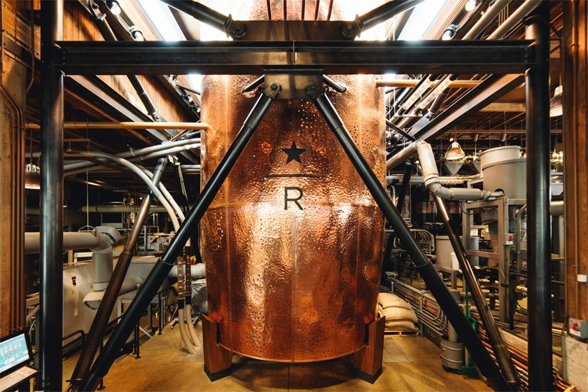 Enormous hammered copper container surrounded by machinery