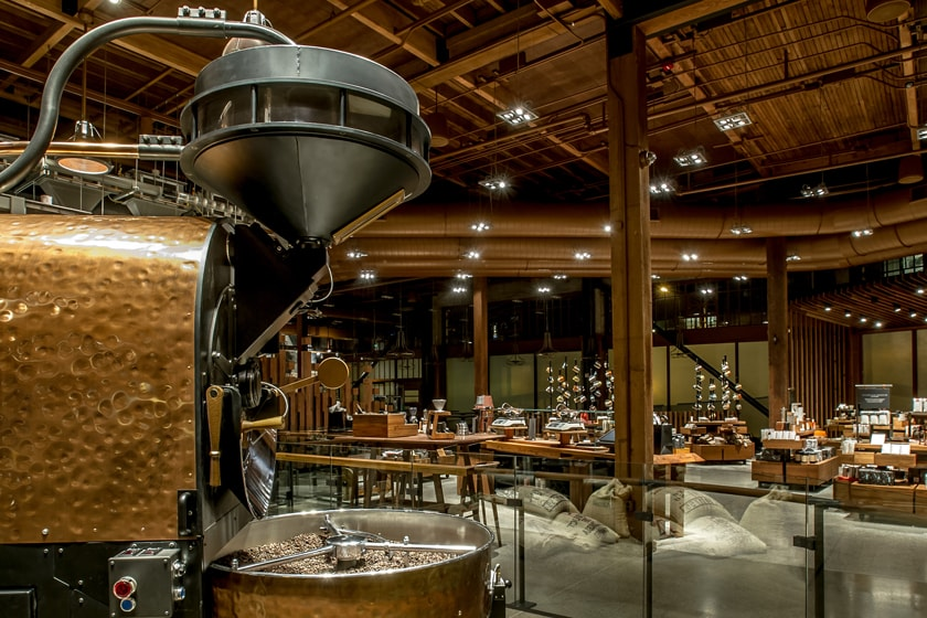 Roaster in foreground with hammered copper roasting chamber with merchandise in the background