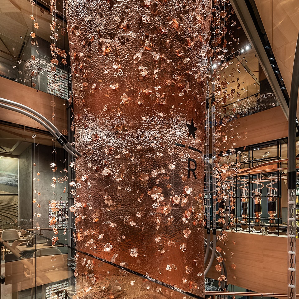 Partial view of the four-story copper cask in the Tokyo Roastery atrium