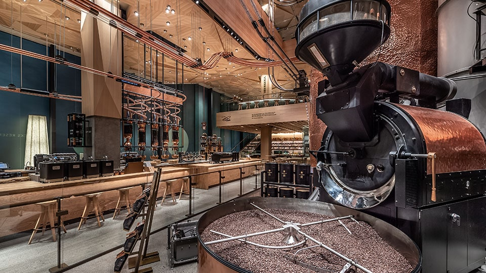 Coffee roasting machinery and the Main Bar on the ground floor of the Tokyo Roastery
