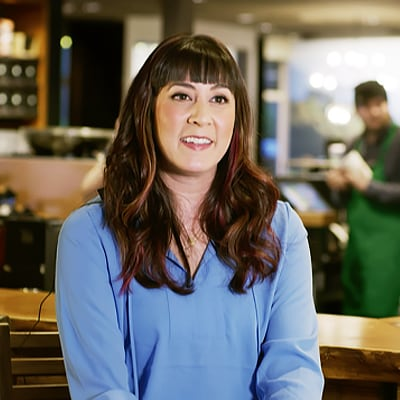 photo of a smiling female store manage with dark brown hair