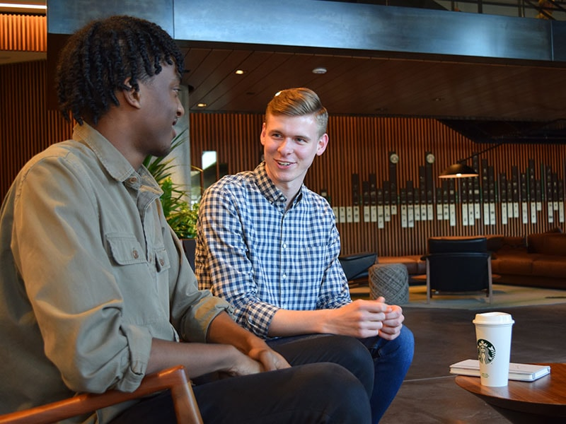 Starbucks interns having conversation