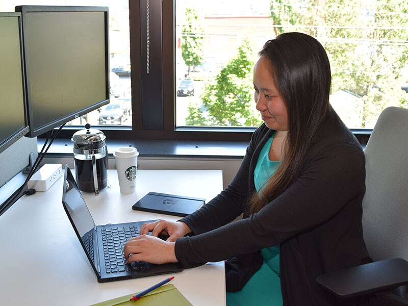 Starbucks intern typing on laptop